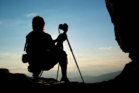 tripod: Silhouette of photographer in mountain. Element of design.
