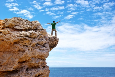 Man on the edge of cliff. Emotional scene. Stock Photo - 8600170