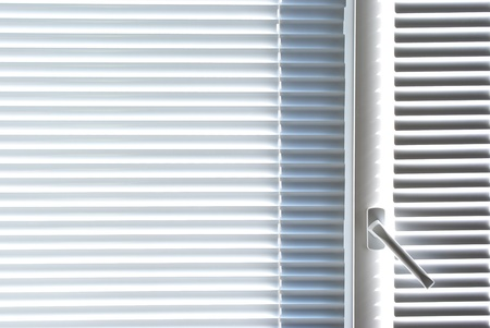 security shutters: Window with white jalousie. Element of interior design.