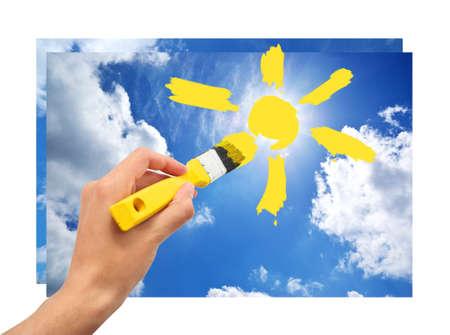 Hand draw the sun in sky. Conceptual design.  photo
