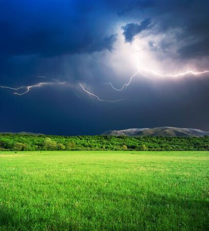 dazzle: Thunderstorm with lightning  in green meadow. Nature composition.