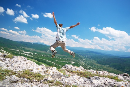 Jump from the cliff.Dinamic and emotional scene. Stock Photo