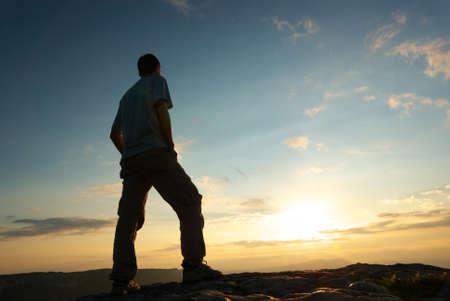 Silhouette of man in mountain. Conceptual scene. Stock Photo - 8696432
