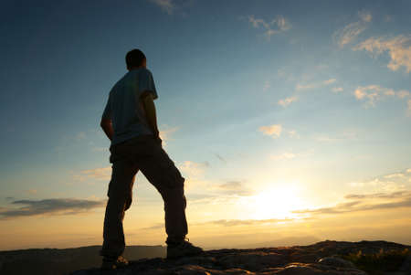 hiker: Silhouette of man in mountain. Conceptual scene.