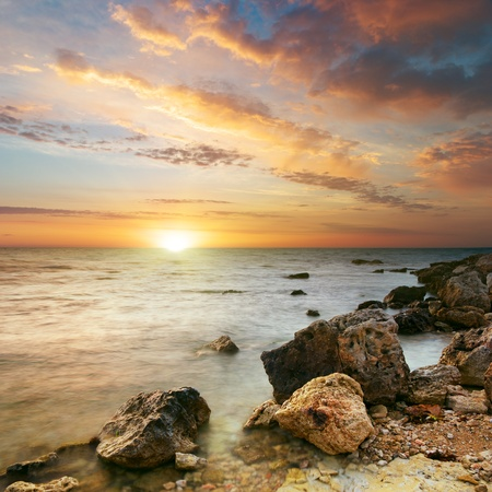 sunset sky: Sea and stone at the sunset. Nature composition.  Stock Photo