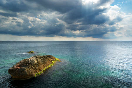 Heavy clouds on sea. Nature composition. photo