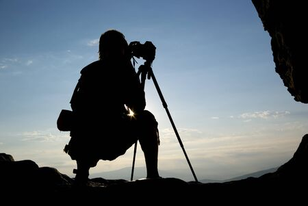 Silhouette of photographer in mountain. Element of design. Stock Photo - 8824252