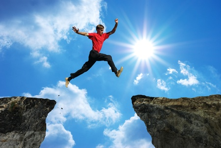 Man jump through the gap. Element of design. photo