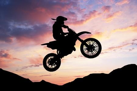 stunts: Moto racer in sunny sky. Element of sport design.