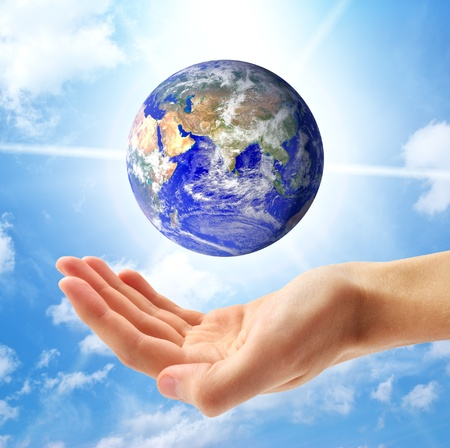 Planet Earth and human hand. Conceptual design. photo