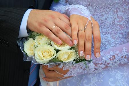 Hands of newlywedses. Element of design. photo