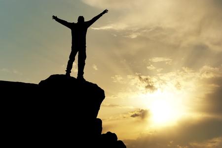 freedom: Man on top of mountain. Conceptual design. Stock Photo