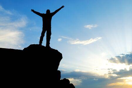 Man on top of mountain. Conceptual design. Stock Photo - 8934601