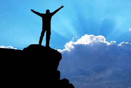 man praying: Man on top of mountain. Conceptual design. Stock Photo
