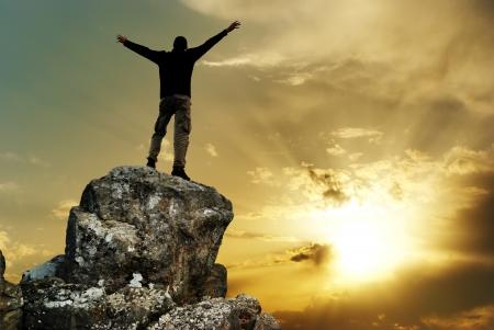 Man on top of mountain. Conceptual design. Stock Photo - 9046039