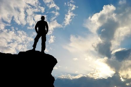 Man on top of mountain. Conceptual design. Stock Photo - 9046032
