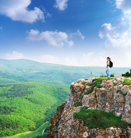 summit: Girl on the peak of mountain. Landscape composition.