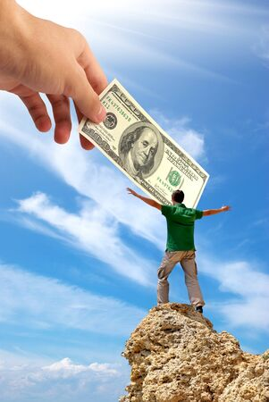 free climber: Man on peak of mountain and hand with money. Money conception design.