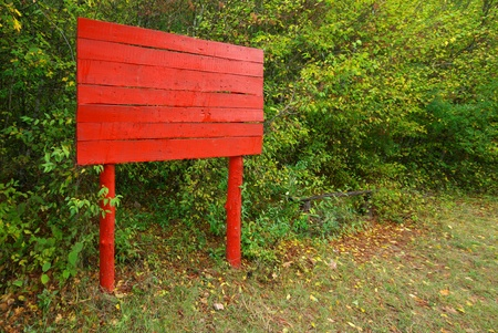 Red notice board in forest. Element of design. photo