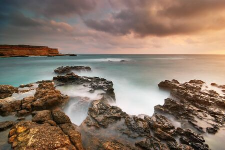 Beautiful seascape. Sea and rock at the sunset. Nature composition. photo