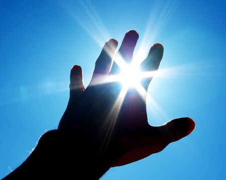 blue light: Hand to sun. Element of design. Stock Photo
