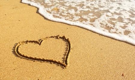 Heart on the snad beach. Conceptual design. photo
