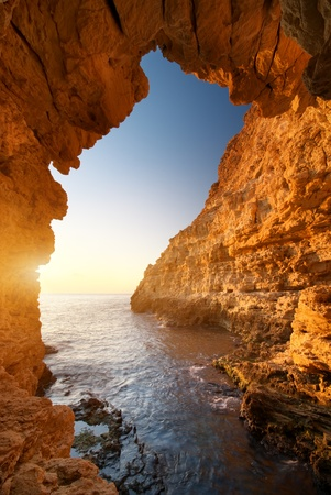 Sunset into grotto. Nature composition. photo