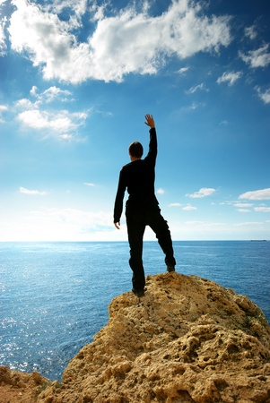 Man on the edge of rock. Element of design. Stock Photo - 9512683