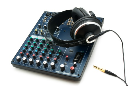 Mixing console and headphones. Element of music design. photo