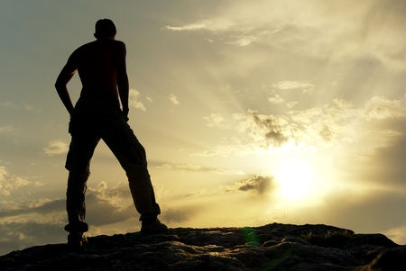 Silhouette of man in mountain. Conceptual scene.  Stock Photo - 9913590