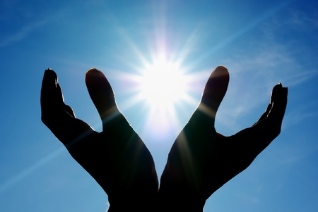 praying: Sun in hands. Conceptual design. Stock Photo