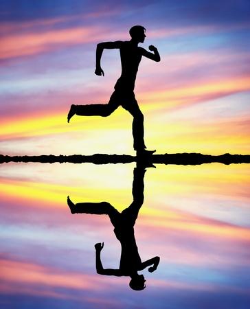 Man run on the sunset. Conceptual scene. photo