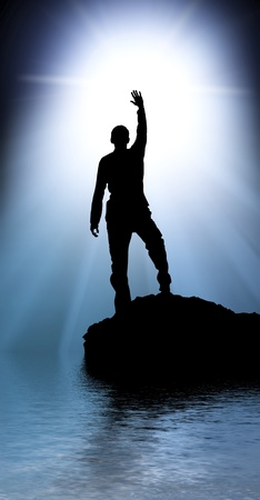 free climber: Silhouette of man touch the sun.