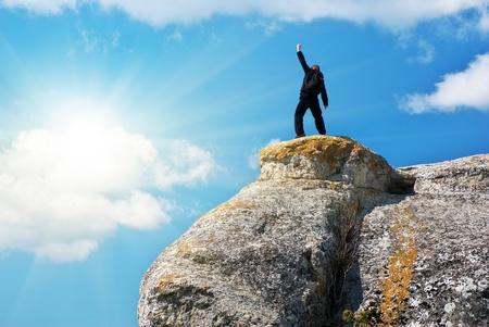 Man on the peak of mountain.  photo