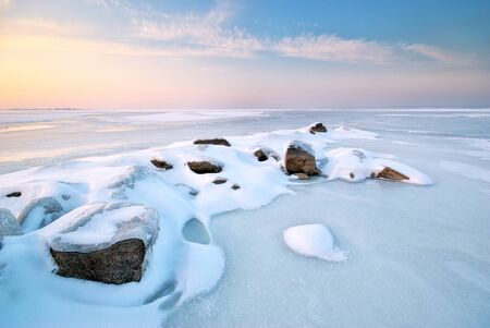 Stone on ice. Winter landscape. photo