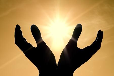 Sun in hands. Conceptual design. photo
