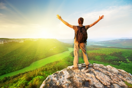 free climbing: Man on top of mountain. Conceptual design. Stock Photo