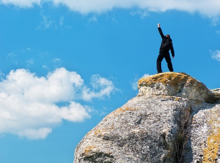 free climber: Man on top of mountain. Conceptual design.  Stock Photo