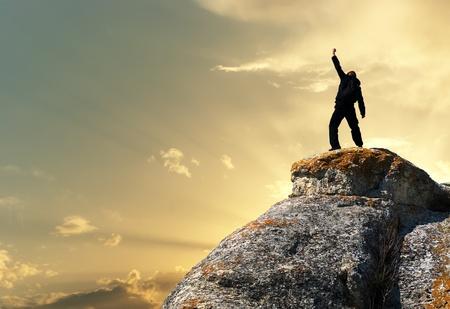 mountaineering: Man on top of mountain. Conceptual design.  Stock Photo