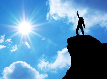 Man on top of mountain. Conceptual design.  스톡 콘텐츠