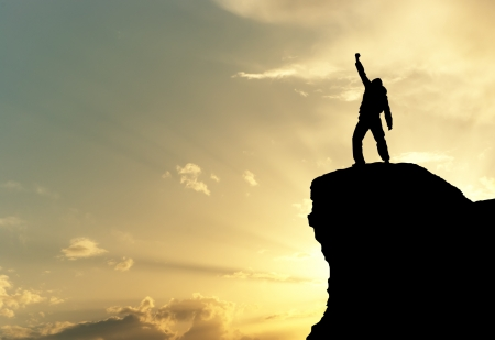 victory stand: Man on top of mountain. Conceptual design.  Stock Photo