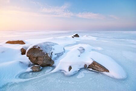 Stone on ice. Winter landscape.  Stock Photo - 10998557