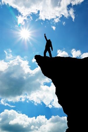mountain  top: Man on top of mountain. Conceptual design.  Stock Photo