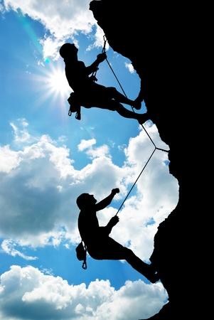 klimmer: Bergbeklimmer op de top. Stockfoto