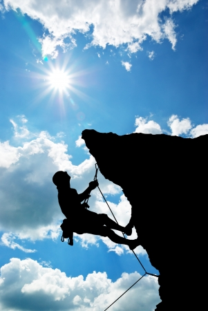 climbing sport: Mountain climber on the top.  Stock Photo