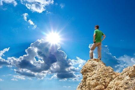 Man on peak of mountain. Conceptual design.  photo