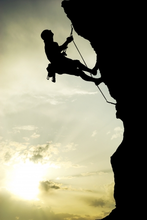 climber: Bergbeklimmer op de top. Stockfoto