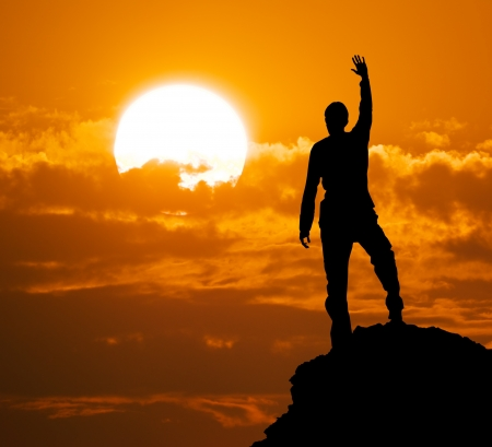 Mountain climber on the top Фото со стока