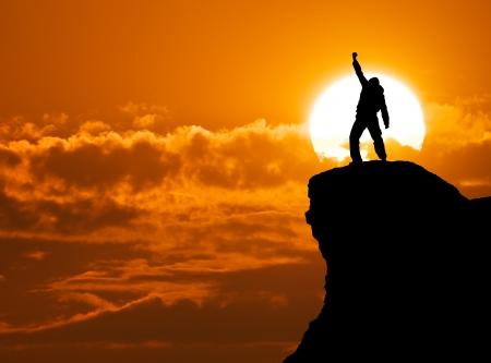 Man on top of mountain. Conceptual design.  Stock Photo
