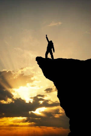 victory: Man on top of mountain. Conceptual design. Stock Photo
